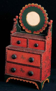 Miniature Dressing Bureau / attributed to Hanson B. Y[o]ungs, 1872–1878, paint on cigar-box wood, cigar-box cardboard, and mirror, 15 1/8 x 7 3/4 x 4 1/2 in., American Folk Art Museum, promised gift of Ralph Esmerian, P1.2001.88. Photo by Stephen Donelian