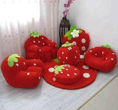 fauteuil et coussin fraise