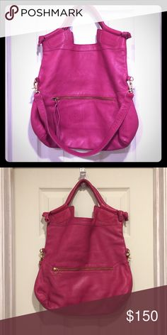 Foley + Corinna large city bag purse pink Foley + Corinna City pink Bag  Sz large  leather outside, lined in cloth  preowned used twice. The bag is in good condition, minor wear on the leather outside with a few very small spots. pebbled leather handbag features tassel pulls at the zip front and back pockets. Double rolled handles and detachable shoulder strap. Lined interior features zip pocket and 2 patch pockets. Feel free to make me an offer!  Height: 16in / 40.5cm Length: 17in / 43cm…