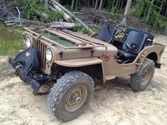 willys jeep m38. Listed as M38 but with the pioneer tool indents on the left and the roof bow brackets it looks more like a early CJ2A ?