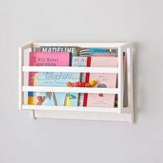 Using wall shelf for books and vertical storage is so great in a small kid space.