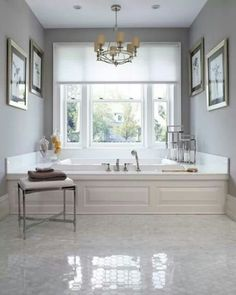 classic/romantic feel.  Like the panels and trim around the bath