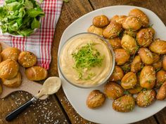 With this recipe, you'll never have to go out for the perfect appetizer again. It makes soft pretzel bites and a perfect beer dipping sauce to go with.