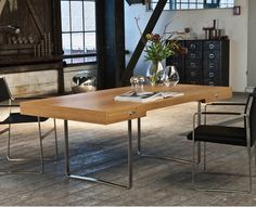 Wegners CH110 desk  is completely different to Wegner's previous designs; the tabletop is streamlined and rests lightly on stainless steel  legs. The desk´s symmetrical drawers features handmade mortise and tenon joints, and stand-out minimalist handles.