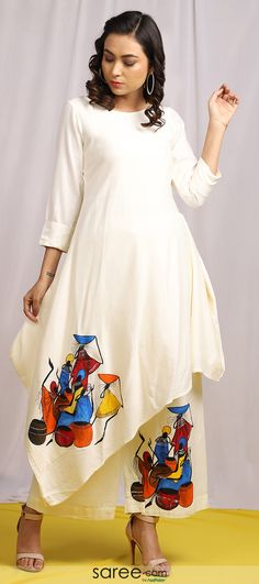 Product Features: Color: White Fabric: Linen Garment Fit: Regular Fit Sleeve Length: Sleeves Neck Type: Round Neck Care Instructions: Dry Clean Only Disclaimer: It is Made to order/Custom made products and cannot be exchanged or returned. Saree Painting Designs, Fabric Paint Designs, Designer Kurtis, Indian Designer Outfits, Designer Dresses, Dress Painting, Fabric Painting, Fabric Paint Shirt, Body Painting
