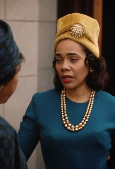 Civil rights activist Mrs. Coretta Scott King with a church hat and outfit leaving church November 1964.