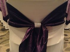 Sparkly chair covers and bow