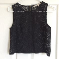 Rachel Roy sleeveless top size 2 (small) Black sheer sleeveless top with exposed zipper in back. Great going out top! Is not cropped but ends right at waist and can be worn over a black tank or even a black bandeau bra. Fits me perfectly and I usually wear an XS. RACHEL Rachel Roy Tops