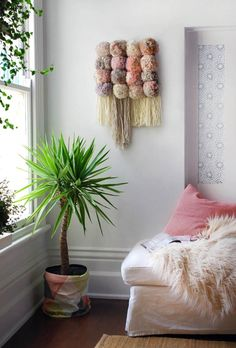 via We Are Scout, link: http://www.we-are-scout.com/2015/04/tutorial-make-a-pom-pom-wall-hanging.html