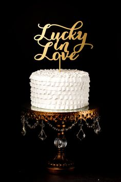 Have you seen this mom? She'll custom write whatever you want as a topper! Wedding Cake Topper - Lucky in Love