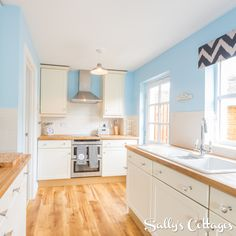 Cook up a Cumbrian feast in this beautiful, contemporary kitchen at Haystacks Cottage! The pastel blue tones and modern counter tops complement perfectly.
