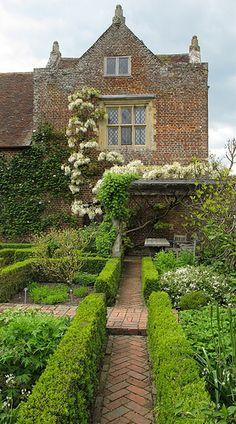 White English Garden, love the brick pathway and climbing wisteria