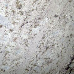 BIANCO GITA. Swirls of grey-black with whisps of gold  and fine garnets on egg shell white. Lovely granite color available at Knoxville's Stone Interiors.  Showroom located at 3900 Middlebrook Pike, Knoxville, TN.  www.knoxstoneinteriors.com  FREE Estimates available, call 865-971-5800