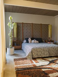 gorgeous!  Love the screen behind the bed!  The horse heads are slightly creepy, though... The Godfather?