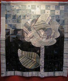 Indigo flower quilt, made from woven rags of indigo. 杉山美紀江 Mikie Sugiyama. 22nd International Quilt Week Yokohama, 2014.  Photo by Queenie's Needlework