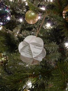 Make an ornament out of leftover wedding invitations. I hope I have one or two spares floating around home to do this!!!