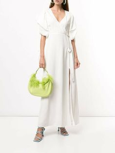 White Merissa wrap maxi dress from CYNTHIA ROWLEY featuring wrap design, plunging V-neck, short sleeves, maxi and adjustable straps.