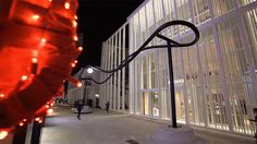 This sculptural light installation in Miami is like a roller coaster for a single light.