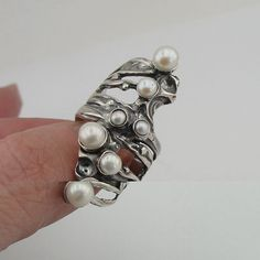 NEW beautiful ring from Hadar collection. This ring is made of sculptural sterling silver, decorated with seven natural pearls (3-6mm). Joy this great new ring!   Labeled and stamped 925. This beauty will be sent to you in a gift package. (All stains, if are any, are due to camera).