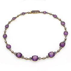 An antique amethyst and diamond necklace, the graduated cushion-cut amethysts intersperesed with old-cut diamond trefoil clusters, mounted in gold and silver, length 37 cm. Russian, C.1900.