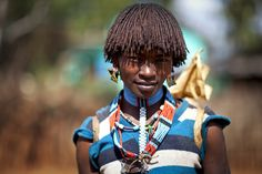 https://flic.kr/p/dzjo5U | Bana girl - Ethiopia | The Bana and the Hamer tribes are very simular.  The Bana also have a bulljumping ceremony where the women are being whipped with sticks.  These women realy force the men to whip them as they are proud of their scars.   © Steven Goethals  Join me on  Facebook