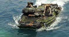 Marine Corps amphibious assault vehicle, carrying Marines assigned to the Marine Expeditionary Unit, returns to the amphibious dock landing ship USS Whidbey Island. Military Gear, Military Weapons, Military Equipment, Us Marines, Army Vehicles, Armored Vehicles, Go Navy, Navy Base, Once A Marine