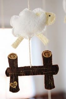 Sheep mobile - free pattern!  Might be able to use the sheep part to make a sheep themed growth chart.