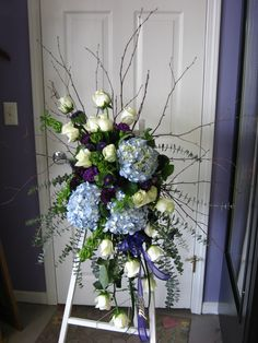 A beautiful sympathy spray by Amazing Petals..love the cool colors