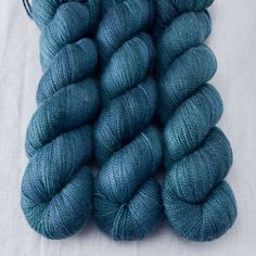 Blue, green, and black are interwoven in this colorway inspired by the traditional Black Watch tartan. Caroline Caroline is lusciously soft, blending super fine merino wool with cashmere and nylon. Th