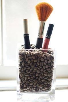 what a smart idea for make up brush storage.  It always did annoy me that when you keep them in a cup they all slump to one side.