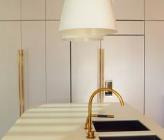 Stunning use of brass in this white kitchen.   Pohio Adams Architects