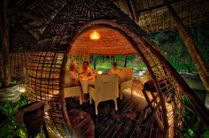 What a cool place to have dinner eh? It reminds me of a little beehive or something like that. This is one of the fabulous dinner spots at Mandapa, a Ritz-Carlton Reserve in Bali. The food was amazingly fabulous and at one point, I even got to go back into the kitchen to have a little explore-time with the head chef. It's always so interesting to see what goes on behind the scenes.  - Bali, Indonesia - Photo from #treyratcliff Trey Ratcliff at http://www.StuckInCustoms.com