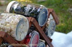 Use an old wine rack for a neat storage solution for jars used in organizing your craft room/pantry/work room!