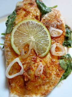 Grilled Chili Lime Talapia    1 pound of Tilapia Filet's (4 fillets)  1 lime-sliced in half  1 Tbs of chili powder  1 Tbs of garlic powder  Coarse sea salt & ground pepper  2 cups of Fresh Spinach  1 tablespoon finely chopped shallot   Olive oil
