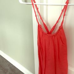 Guess Knotted Halter w/ Open Back Super fun shirt for the spring/summer! In good-great condition, it was my favorite for a while... Beautiful coral color and soft! Guess Tops Tank Tops
