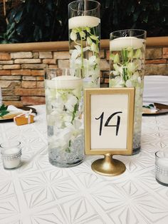 White Orchid Submerged with Floating Candle Wedding Centerpiece @ St. John's :: The Vines Flower & Garden Shop