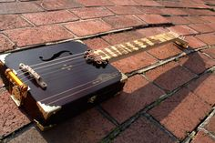4-string Handmade Acoustic Cigar Box Guitar with Exotic Hardwood Overlay.