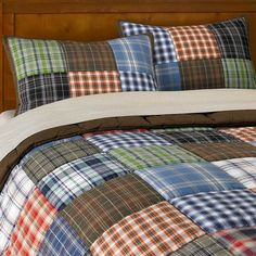 These would be so nice on the boys' beds Patchwork Quilt (This is from pottery barn)