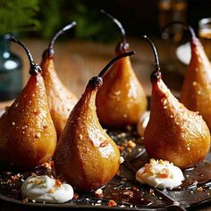 Roasted Pears with Lemon Cream and Candied Pine Nuts: This grand finale of a dessert features maple-burnished pears, drifts of lemony whipped cream and a sprinkling of candied pine nuts. Recipe: http://www.midwestliving.com/recipe/roasted-pears-with-lemon-cream-and-candied-pine-nuts-1/
