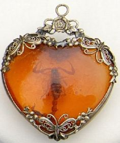 RARE ANTIQUE SILVER AMBER SCORPION CAMEO HEART PENDANT sold for $152.