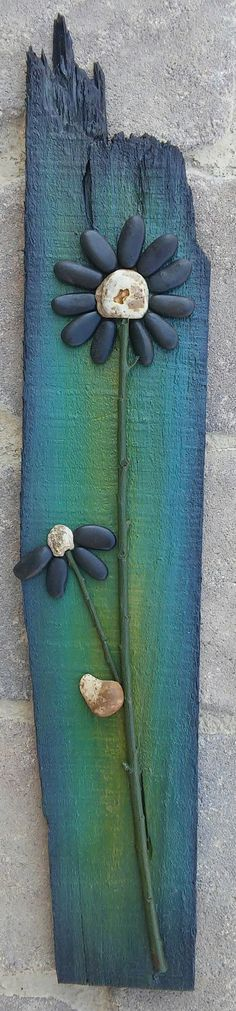 Original pebble/rock art depicting black flowers (all natural materials including reclaimed wood, pebbles, twigs) 21x4