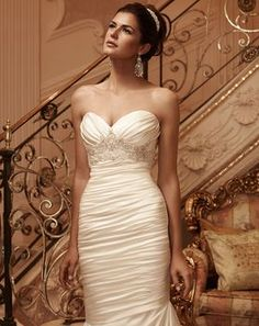 Ruched, stretch Perfecting Satin sweetheart neckline. Front and back bodice is accented with Swarovski Crystals, pearls and rhinestones beaded appliqué. ...