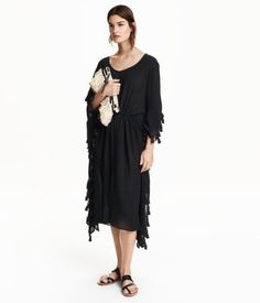 Black. Calf-length kaftan dress in woven, crinkled viscose fabric with decorative trim. V-neck, drawstring at waist, and slits at sides. Unlined.