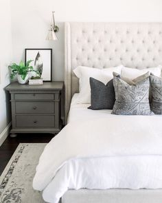 white and gray bedroom // white tufted headboard // gray nightstand