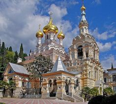 The Alexander Nevsky Cathedral is a cathedral in Yalta, Crimea, built in and designed by Nikolay Krasnov. Russian Architecture, Sacred Architecture, Religious Architecture, Church Architecture, Beautiful Architecture, Beautiful Castles, Beautiful Buildings, Cathedral Church, Interesting Buildings