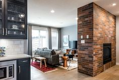 This brick wall is a nice touch to separate the great room from the kitchen nook