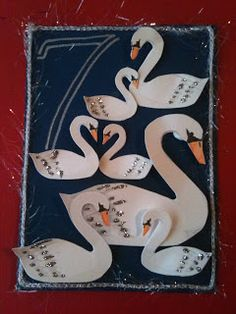 7 swans a swimming