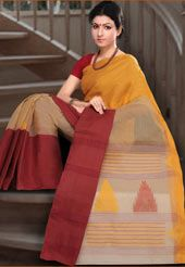 Traditional fawn and mustard resham woven handloom cotton tant saree from bengal. As shown red plain cotton blouse fabric can be made available and the same can be customized in your style or pattern; subject to fabric limitation, as the fabric is just drape on the model. (Slight variation in color is possible.)