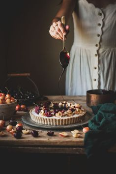 This Coconut Malabi Tart is gluten-free, dairy-free, vegan friendly, and topped with toasted coconut and cherries cooked in a wine syrup. Cheesecake Toppings, Cherry Wine, Cherry Tart, Toasted Coconut, Tart Cherries, Food Styling, A Table, Dairy Free, Gluten Free