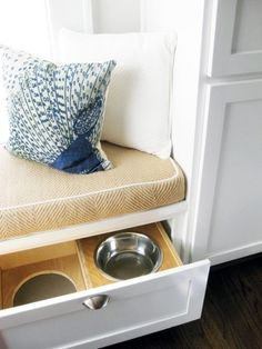 TerraCotta Properties    Gorgeous pet friendly kitchen with built-in banquette with butter yellow fabric cushion and built-in dog food and water drawer.